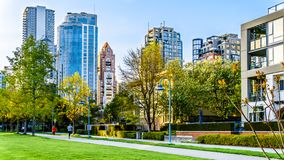 Skyscapers lining the skyline of Yaletown and David Lam Park along False Creek Inlet of Vancouver, British Columbia, Canada. Vancouver. BC/Canada-April 24, 2019 royalty free stock images