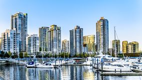 Skyscapers lining the skyline of Yaletown with Quayside Marina along False Creek Inlet of Vancouver, British Columbia, Canada. Vancouver. BC/Canada-April 24 stock images