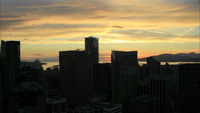 Vancouver BC Canada Downtown City Silhouette at Golden Sunset Time Lapse stock video footage