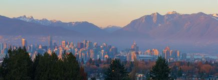 Vancouver BC Canada Downtown Cityscape at Sunset Panorama. Vancouver British Columbia Canada city skyline and mountain view during sunset panorama Stock Photos