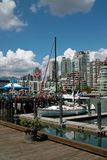 Vancouver BC, Canada. Granville Island and Market, foreground, is just a water taxi ride away from apartments on False Creek royalty free stock photos