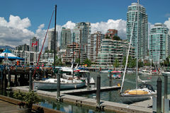 Vancouver BC, Canada. Granville Island and Market, foreground, is just a water taxi ride away from apartments on False Creek stock photo