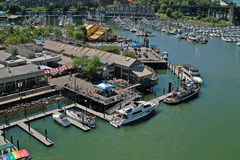 Vancouver BC, Canada. Granville Island and Market is just a water taxi ride away from apartments on False Creek stock photography