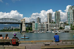False Creek, Vancouver BC, Canada. Granville Island and Market is just a water taxi ride away from apartments on False Creek. Burrard Bridge is in the background stock photo