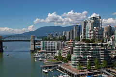 Vancouver BC, Canada. With a great view of the North shore mountains, these popular apartment buildings in the West end of Vancouver are also within walking stock photography