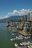 Vancouver BC, Canada. With a great view of the North shore mountains, these popular apartment buildings in the West end of Vancouver are also within walking stock photo