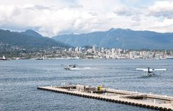 VANCOUVER, BC, CANADA - JUNE 06, 2016: Harbour Air Dehavilland Otters in Vancouver`s Coal Harbour. VANCOUVER, BC, CANADA - JUNE 06, 2016: Harbour Air royalty free stock photography