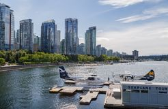 VANCOUVER, BC, CANADA - JUNE 06, 2016: Harbour Air Dehavilland Otters in Vancouver`s Coal Harbour. VANCOUVER, BC, CANADA - JUNE 06, 2016: Harbour Air stock image