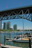 Vancouver BC, Canada. Sailboat moored below Burrard Bridge stock image