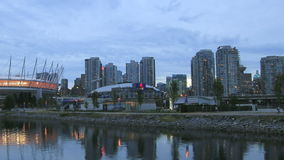 Vancouver BC Canada with Scenic View of Office Condominium Buildings Clouds and Moving Traffic along False Creek Stock Photo