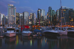 Vancouver BC downtown skyline & marina at dusk Royalty Free Stock Images