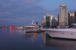 Vancouver BC & yachts at dusk, Canada. Stock Image