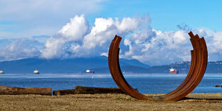 Vancouver beach art. The sculpture Arcs 217.5 x 13, beach art on Sunset Beach facing English Bay in Vancouver, Canada.  Bernar Venet's piece was part of Stock Photos
