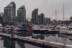 Vancouver, British Columbia/Canada - December 24 2017: waterfron. T in downtown with some boats and skyscrapers reflecting in the water Royalty Free Stock Images