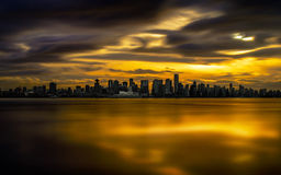 Vancouver Burning Sunset. Shot from Lonsdale Quay in North Vancouver, looking south west to downtown Vancouver, British Columbia Royalty Free Stock Images