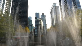 Vancouver business district. Water fountains tall offices buildings stock footage
