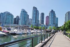 Vancouver Waterfront. VANCOUVER, CA- JUNE 25: Downtown Vancouver Waterfront, and Lifestyle on June 25 , 2011 in Vancouver, CA Vancouver has prominent buildings royalty free stock photo
