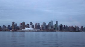Vancouver Canad evening wide shot. Vancouver panoramic downtown dusk waterfront stock footage