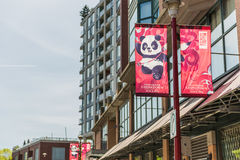 Vancouver, Canada - April 19, 2016: Chinatown in downtown with banner and panda culture symbol with text of since 1885 Stock Image