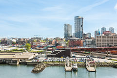 Vancouver, Canada - April 19, 2016: City downtown skyline or cityscape with industrial port with cars, cargo, containers and train Royalty Free Stock Photography