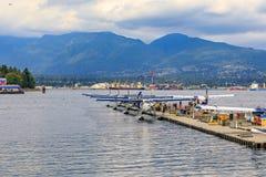 De Havilland Beaver sea planes docked at Harbour Airport at Coal. Vancouver, Canada - August 04, 2018: De Havilland Beaver sea planes docked at Vancouver`s stock image