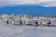 De Havilland Beaver sea planes docked at Harbour Airport at Coal. Vancouver, Canada - August 04, 2018: De Havilland Beaver sea planes docked at Vancouver`s royalty free stock photography