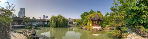 VANCOUVER, CANADA - AUGUST 10, 2017: Tourists in Dr Sun Yat-Sen. Classic Chinese Garden. Vancouver attracts 20 million people annually Royalty Free Stock Images