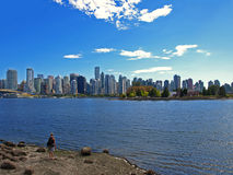 Vancouver Canada cityscape. With towers, sky and girl Royalty Free Stock Images
