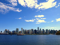 Vancouver Canada cityscape. With towers, sky and girl Stock Photos