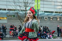 VANCOUVER, CANADA - DECEMBER 2, 2018: girl on monocycle at annual The Santa Claus Parade in Vancouver, Canada. royalty free stock images