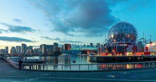 Time lapse of False Creek and Vancouver skyline, including World of Science Dome stock video footage