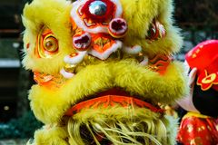 Free VANCOUVER, CANADA - February 18, 2014: People In Yellow Lion Costume At Chinese New Year Parade In Vancouver Chinatown. Stock Photos - 110714293