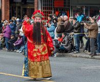 VANCOUVER, CANADA - February 2, 2014: Chinese Character leads off the Lunar New Year Parade in Vancouver Chinatown. Royalty Free Stock Images