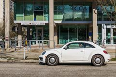 VANCOUVER, CANADA - February 25, 2018: Early 60s VW Beetle parked in a street near java express cafe. royalty free stock photo