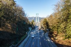 VANCOUVER, CANADA - February 25, 2019: Lions Gate Bridge or First Narrows Bridge in Vancouver with Traffic stock photo
