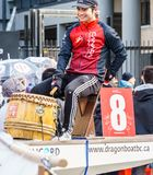 VANCOUVER, CANADA - February 18, 2018: Man in dragon boat at Chinese New Year parade in Vancouver Chinatown. stock photos