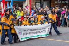 VANCOUVER, CANADA - February 2, 2014: The 28th Kitsilano Scout Group marching during Chinese New Year parade stock photos