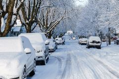 VANCOUVER, CANADA - February 24, 2018: Winter morning after a night of snow blizzard cars in snow. VANCOUVER, CANADA - February 24, 2018: Winter morning after a stock photo