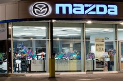Vancouver. Canada - January 9, 2018: Mazda logo on the facade of official dealer office. Mazda Motor Corporation is a Japanese car. Brand, automotive Stock Photography