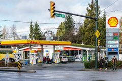 VANCOUVER, CANADA - January 21, 2018: Shell gas station and Convenience Store at Arbutus Street and Broadway. VANCOUVER, CANADA - January 21, 2018: British Dutch royalty free stock photo