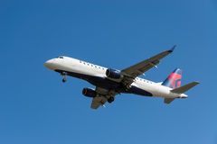 Delta Airlines aircraft. VANCOUVER, CANADA - MARCH 28, 2013: Delta Airlines Embraer 175 aircraft on final approach to Vancouver International Airport on March 28 Royalty Free Stock Photo
