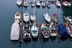 Vancouver, CANADA - March, 2018 : Sailboat at dock at False Creek between Granville Street Bridge and Burrard Street Bridge. Vancouver in Canada Royalty Free Stock Photography