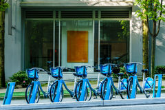 Vancouver Canada - May 6, 2017, shared bicycles parking in Downtown in front of a suit building Royalty Free Stock Images
