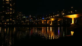 Vancouver Canada nightdowntown waterfront. Illuminated Cambie bridge Vancouver downtown stock footage