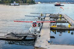 Seaplanes/Float Planes/ Pontoon Planes docked in Coal Harbour, downtown Vancouver, British Columbia stock photos