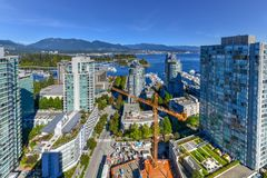Vancouver, Canada Skyline. Aerial view of the modern city skyline of Vancouver, British Columbia, Canada during a sunny day stock image