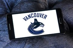 Vancouver Canucks ice hockey team logo. Logo of Vancouver Canucks ice hockey team on samsung mobile. The Vancouver Canucks are a professional ice hockey team Royalty Free Stock Photos