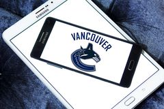 Vancouver Canucks ice hockey team logo. Logo of Vancouver Canucks ice hockey team on samsung mobile. The Vancouver Canucks are a professional ice hockey team Royalty Free Stock Photo
