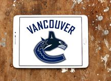 Vancouver Canucks ice hockey team logo. Logo of Vancouver Canucks ice hockey team on samsung tablet. The Vancouver Canucks are a professional ice hockey team Royalty Free Stock Images