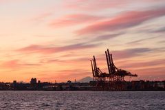 Vancouver Cargo Cranes at Sunrise Royalty Free Stock Image